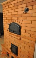 Отопительная каминопечь с хлебной камерой и туннельной топкой